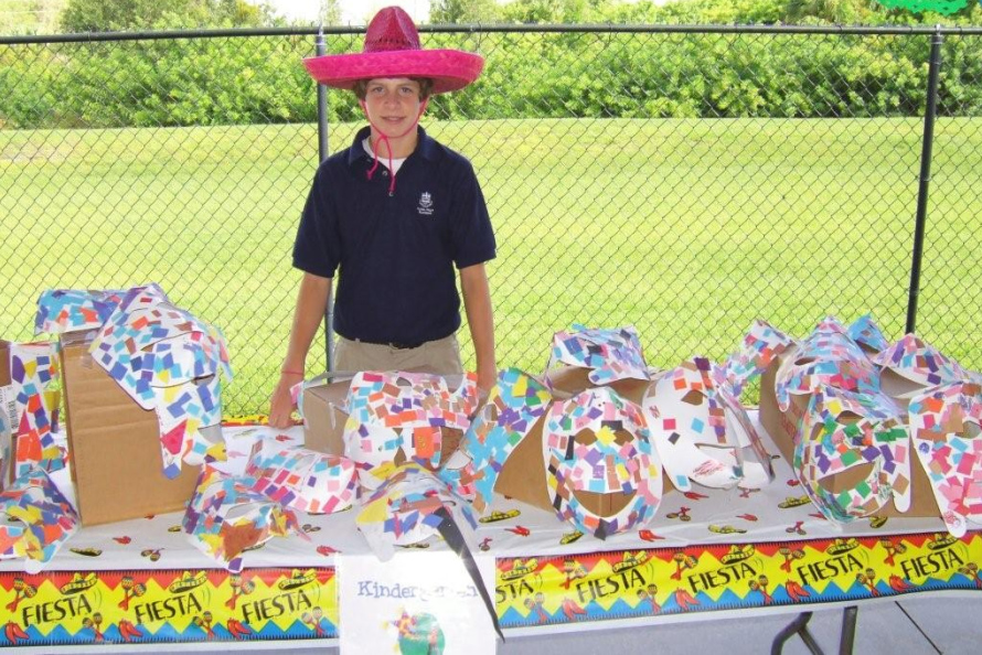 An 8th grade Royal Palm Academy student working a booth at the Hispanic festival.