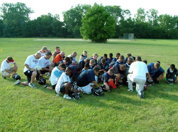 A moment of prayer on the playing field.