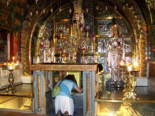 Touching the rock of Calvary under the altar in the Church of the Holy Sepulcher.