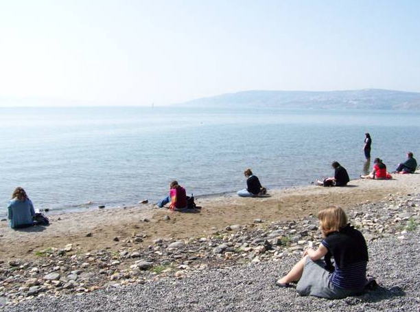 The co-workers share a time of prayer on the shores of the Sea of Galilee.