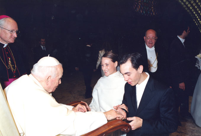 Sally and Paul d�Assumpcao receiving the Pope�s blessing while on their honeymoon in Rome.